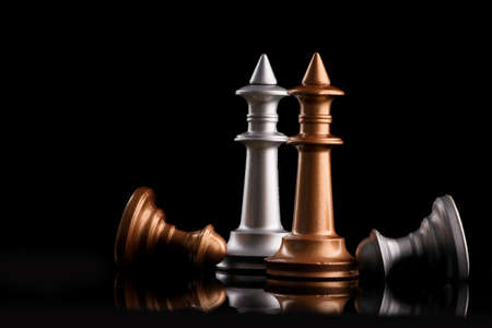 The concept of leadership and victory with the chess king and figures on a black background
