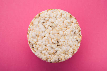Crispbreads or diet rise crackers on a pastel pink background. healthy dieting cookie
