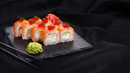philadelphia sushi with salmon on a black background. Japanese food. Copy space for text Stock Photo