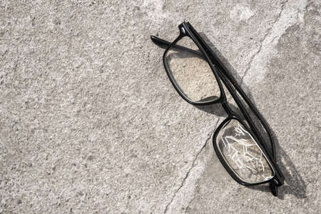 Broken glasses lying on the street asphalt. an unpleasant situation on the road