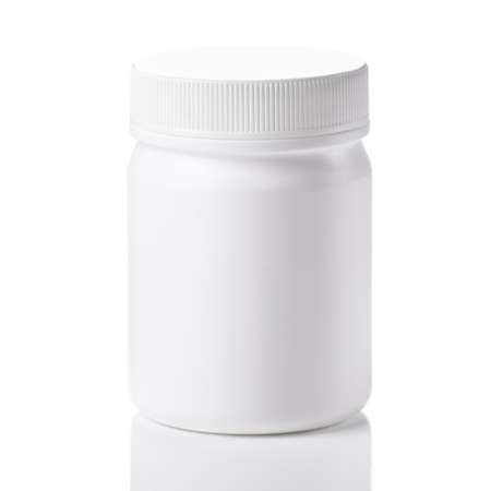 Medicine bottle with pills isolated on a white background.