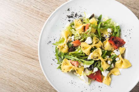 Fresh pasta salad with cheese feta and rucola. Top view. Stock Photo