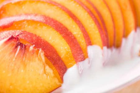 closeup of peach slices and yogurt background