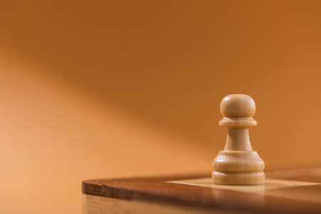 Closeup of one wooden chess pieces pawn