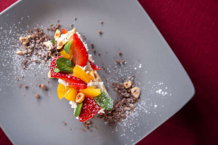 Tasty fresh italian mille-feuille dessert with strawberry on a restaurant table. top view Stock Photo
