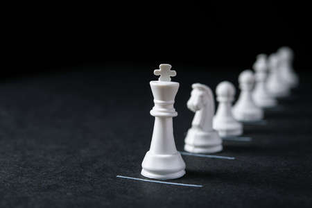 Chess pieces on a dark with constraint lines.