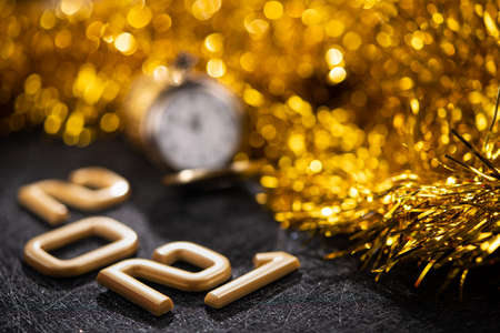 Golden 2021 number on a black background. Happy New Year celebrate banner. Stockfoto