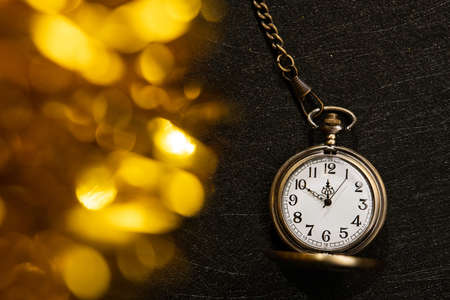Golden stopwatch time to New Year. 10 minutes to midnight. gold scenery bokeh.