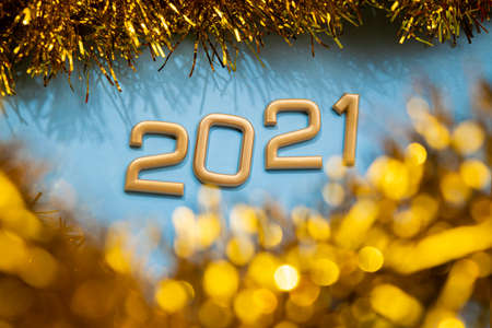 Happy New Year 2021 golden numbers on a blue background. Top view. Stockfoto