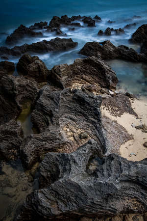 A carved rock on the sea - long exposure painterly photo Stock Photo