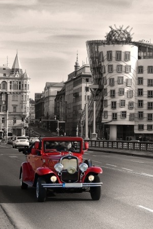 Prague, Czech republic, on January 1, 2013 - Vintage Car and dancing house in Prague