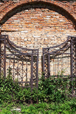 old iron gates on a brick masonry  photo