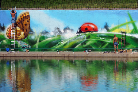MOSCOW-JULY 13, graffiti in the pond Chertanovo Balaclava Avenue in Moscow .13.07.2013. street artists decorate the wall. Russia.