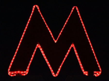 letter 'M' sign subway station. photo