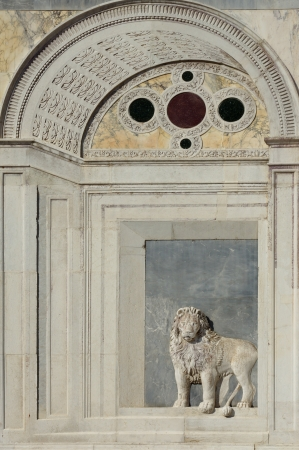 architectural heritage of the world: marble bas-relief of a lion on Campo Santi Giovanni e Paolo in Venice, Italy. Editorial