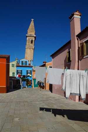 drying clothes on a background of multi-colored facades of the island of Burano, Venice, Italy. photo