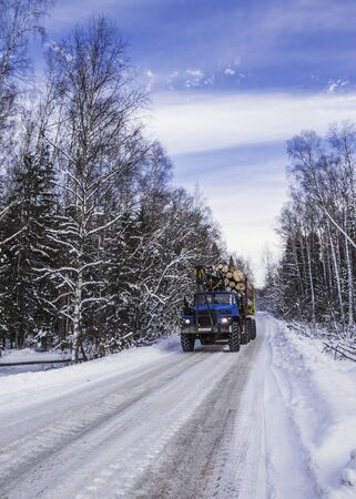 timber transport on the winter road photo