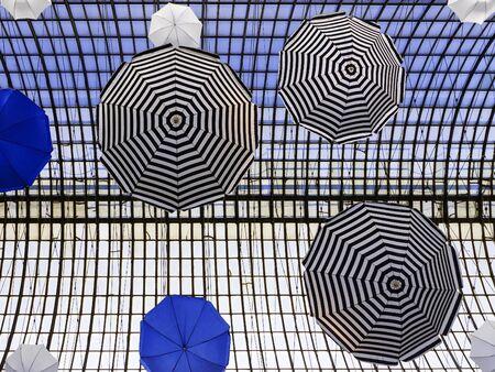 colorful umbrellas (arch design in the building) photo