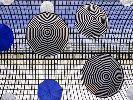 brolly: colorful umbrellas (arch design in the building) Stock Photo