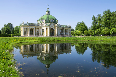 kuskovo: Grotto pavilion with reflection in the water park Kuskovo, Moscow, Russia Stock Photo