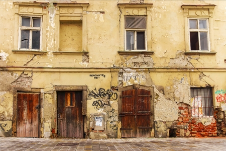 dilapidated: facade of the old dilapidated house Stock Photo