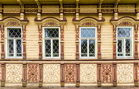 carved facade of a wooden house