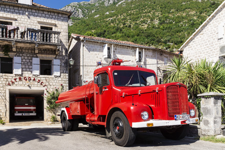 antique fire truck: PERAST, MONTENEGRO - AUGUST 27. fire retro car on the waterfront town of Perast on 27 August. Old town in Montenegro. Located on the shores of Boka Bay of the Adriatic Sea