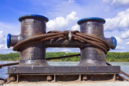 mooring bollards: Mooring bollards with a metal cable on the pier