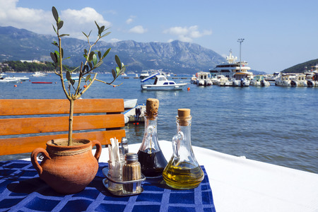 Served table on sea beach restaurant of Budva, Montenegro. Banque d'images