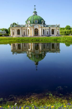 Grotto pavilion with reflection in the water park Kuskovo, Moscow, Russia Editorial