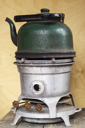 primus: old kerosene stove with a sooty kettle