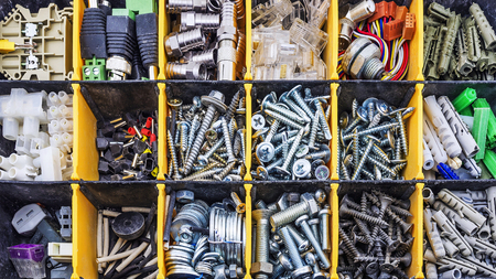 gudgeon: Screw and dowel in plastic organizer box Stock Photo