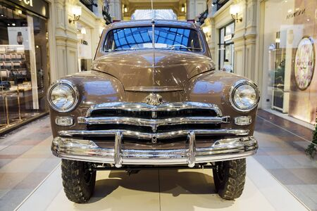parade of homes: MOSCOW, RUSSIA-JULY 11: Exhibition of Soviet vintage cars in the store GUM August 11, 2015. The legendary Soviet car Pobeda is produced at the Gorky Automobile Plant in 1946-1958 years
