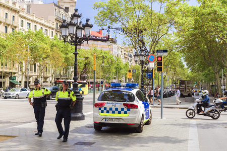 CIA: BARCELONA, SPAIN - SEPTEMBER 15: Spanish police on Passeig de Gràcia in Barcelona, September 15, 2015.