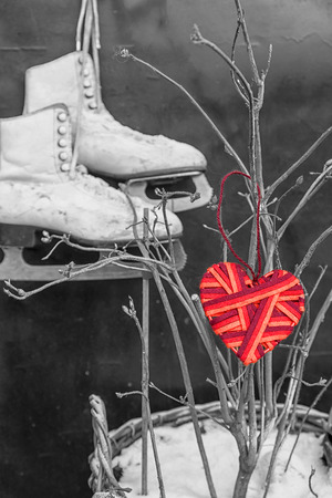 shoestrings: red heart on the background of a pair of skates. theme for Valentines Day Stock Photo