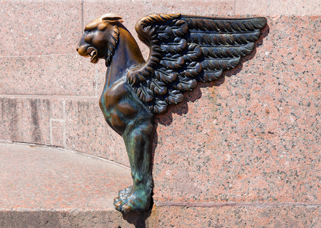 Sculpture of griffin on embankment of the Neva river in the city St Petersburg, Russia Editorial