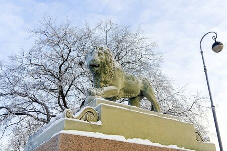 noteworthy: Winter embankment of the Neva River, snow lion statues Stock Photo