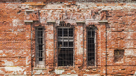 The facade of the old building of red brick