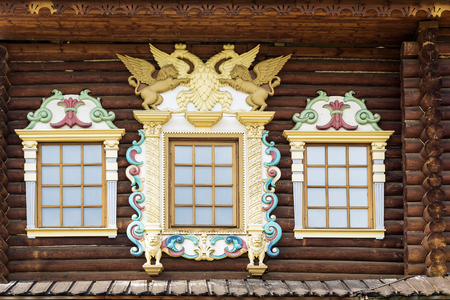 facade of the old Russian chopped house with carved wooden architraves