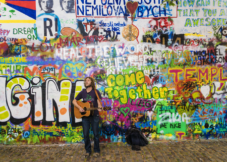 PRAGUE, CZECH REPUBLIC - MAY 20: Street musician performs songs about John Lennon Wall in Prague May 20, 2016