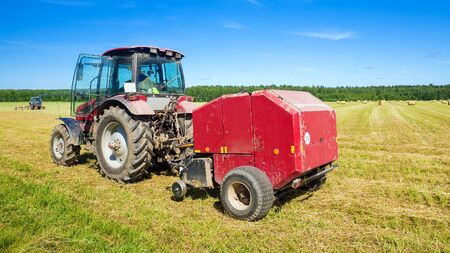 agricultural machinery on the hay Stock Photo