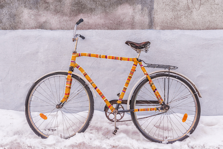 Bike insulated knitted garment decorated on a snowy street Stock Photo