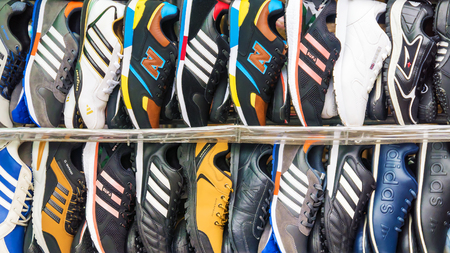 adidas: ST. PETERSBURG. RUSSIA - SEPTEMBER 26, 2016: counterfeit sports mens shoes of famous brands to showcase the glove wound in St. Petersburg