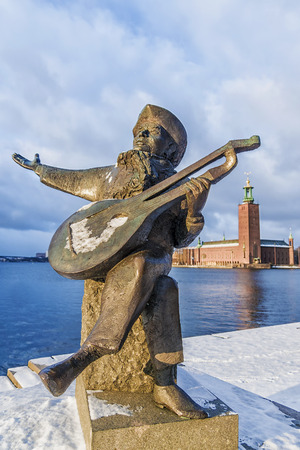 Everts monument on the background of the town hall in Stockholm, Sweden