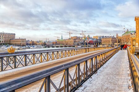 corona navidad: winter view of the Bridge of Skeppsholmen in Stockholm.