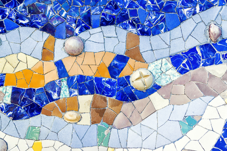 trencadi: Closeup of mosaic of colored ceramic tile by Antoni Gaudi at his Parc Guell, Barcelona, Spain