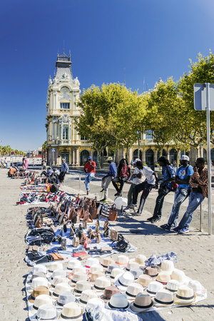 counterfeit: BARCELONA, SPAIN - SEPTEMBER 17, 2015: illegal street dealers sell counterfeit products of the known brands at in Barcelona