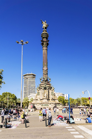 counterfeit: BARCELONA, SPAIN - SEPTEMBER 17, 2015: illegal street dealers sell counterfeit products of the known brands at a monument to Columbus in Barcelona Editorial