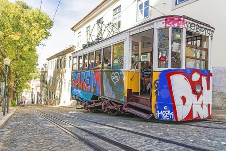 bica: LISBON, PORTUGAL - SEPTEMBER 9, 2015: Tram Tram  elevator in a narrow street in Lisbon