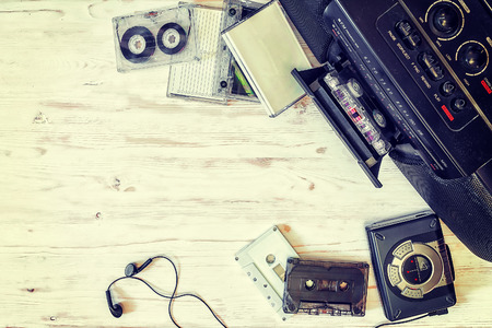 cassette player, cassette recorder and audio tape on a wooden background